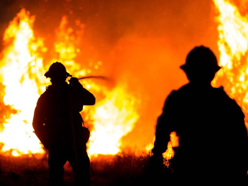 Firefighters battle the Bobcat Fire burning in Juniper Hills, California, Saturday, Sept. 19, 2020.