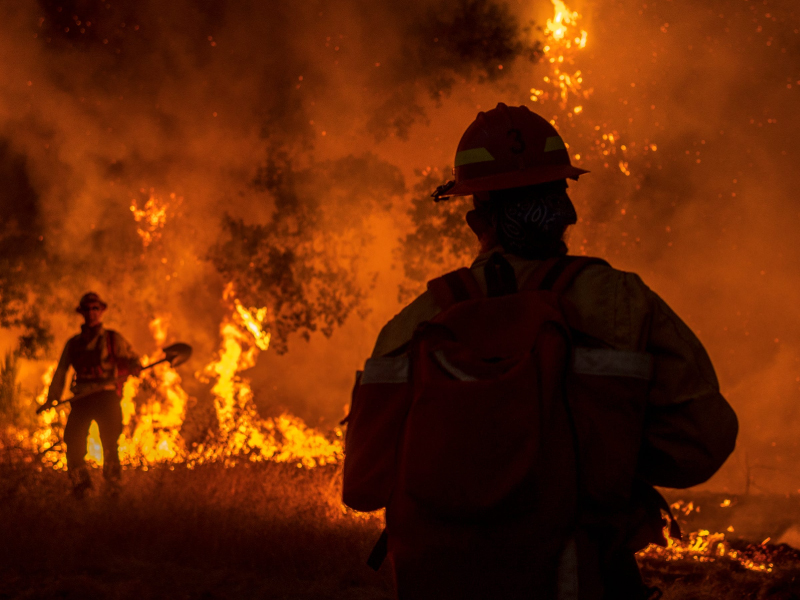 Firefighters battle the Zogg Fire burning in Shasta County, California, Sept. 27, 2020.